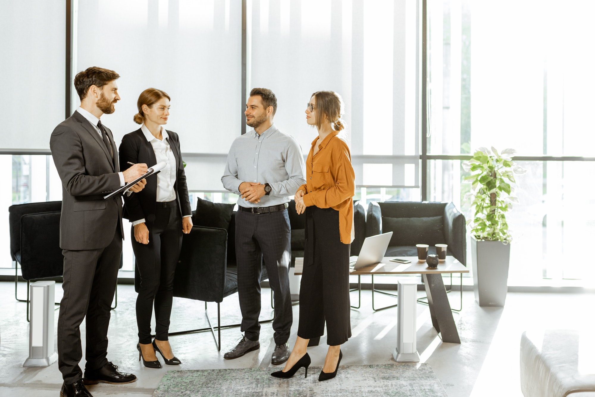 Couple with business consultants at the office